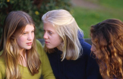 Three girls talking