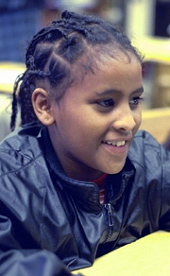 Child in black jacket
