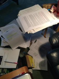Piles of notes for The Perfection Deception